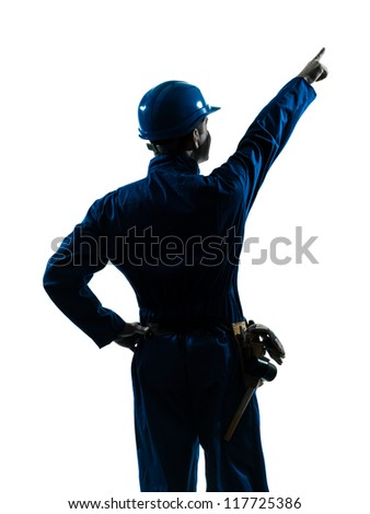 one caucasian man construction worker pointing showing silhouette portrait in studio on white background - stock photo