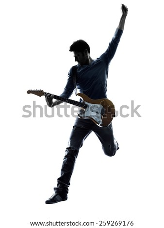 one caucasian man electric guitarist player playing in studio silhouette isolated on white background - stock photo