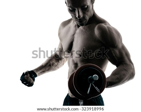 one caucasian man exercising fitness body building exercises in studio in silhouette isolated - stock photo
