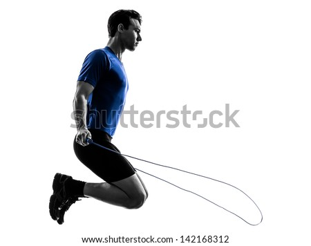 one caucasian man exercising jumping rope in silhouette studio  on white background - stock photo