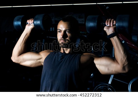 one caucasian man exercising weight training workout fitness in gym - stock photo