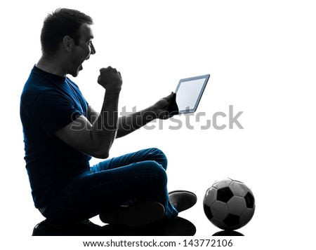 one caucasian man holding digital tablet   in silhouette on white background - stock photo