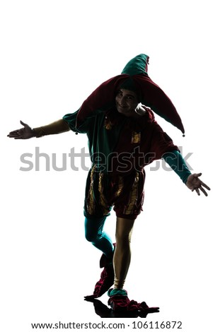 one caucasian man in jester costume saluting silhouette in studio isolated on white background - stock photo