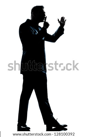 one caucasian man menace hushing for silence full length silhouette in studio isolated white background