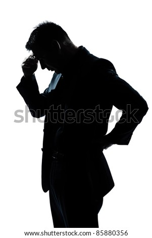 one caucasian man portrait silhouette thinking looking down in studio isolated white background - stock photo