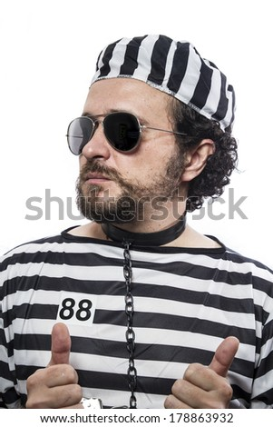 one caucasian man prisoner criminal with chain ball and handcuffs in studio isolated on white background - stock photo