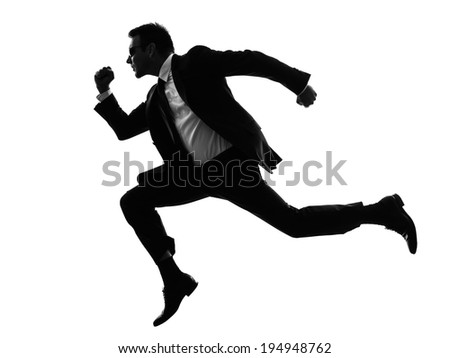one caucasian man running secret service in silhouette on white background - stock photo