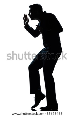 one caucasian man walking tiptoe quietly  full length silhouette in studio isolated white background