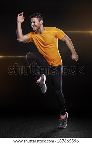 one caucasian man young sprinter runner running in silhouette studio on black background - stock photo