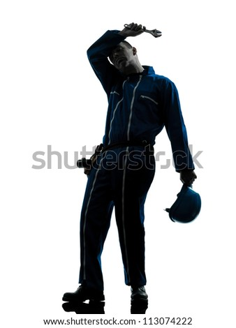 one caucasian repairman worker tired fatigue silhouette in studio on white background