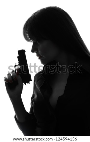 one caucasian sexy detective  woman holding  gun in silhouette studio isolated on white background - stock photo