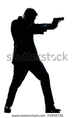 one caucasian spy criminal policeman detective man aiming shooting gun  full length silhouette in studio isolated white background - stock photo