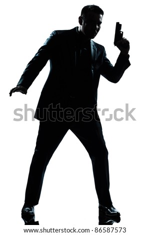 one caucasian spy criminal policeman detective man holding gun full length silhouette in studio isolated white background