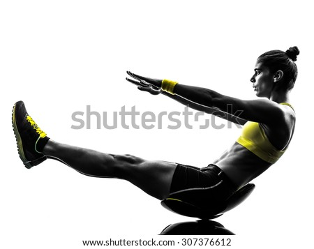one caucasian woman exercising  crunches fitness in studio silhouette isolated on white background - stock photo