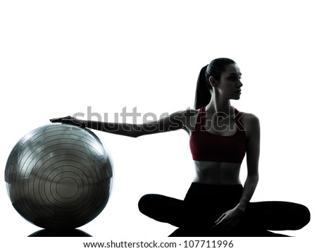 one caucasian woman exercising fitness ball in silhouette studio isolated on white background - stock photo