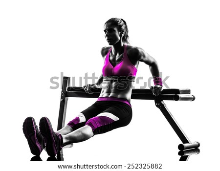 one caucasian woman exercising  fitness bench press  push-ups  in studio silhouette isolated on white background - stock photo