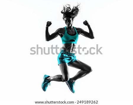 one caucasian woman exercising  fitness jumping in studio silhouette isolated on white background - stock photo
