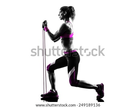 one caucasian woman exercising  fitness resistance bands in studio silhouette isolated on white background - stock photo