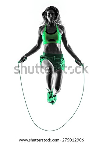 one caucasian woman exercising  Jumping Rope fitness in studio silhouette isolated on white background - stock photo