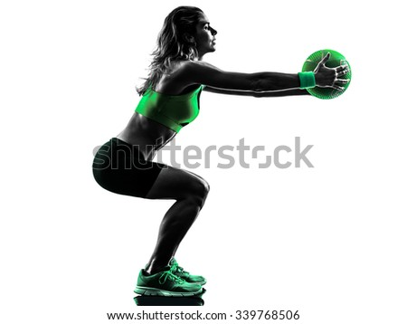 one caucasian woman exercising Medicine Ball  fitness in studio silhouette isolated on white background - stock photo