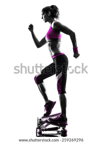 one caucasian woman exercising stepper fitness in studio silhouette isolated on white background - stock photo
