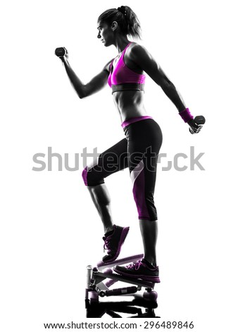 one caucasian woman exercising stepper with weights fitness in studio silhouette isolated on white background - stock photo