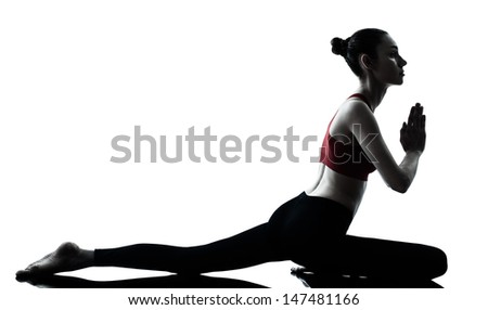 one caucasian woman exercising yoga in silhouette studio isolated isolated on white background - stock photo