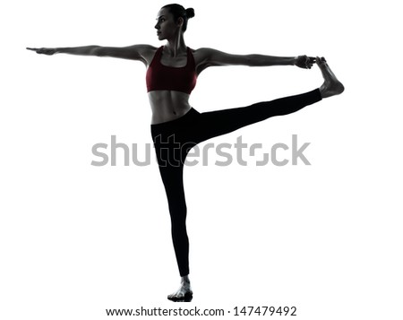 one caucasian woman exercising yoga  Revolved Hand to Big Toe Pose in silhouette studio isolated on white background - stock photo