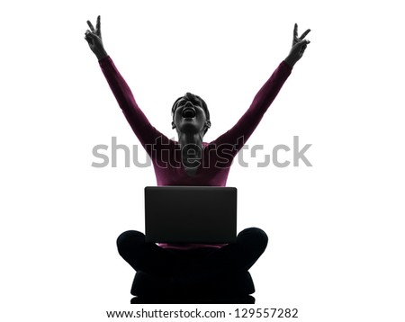 one caucasian woman happy winning  computing laptop computer  in silhouette studio isolated on white background - stock photo