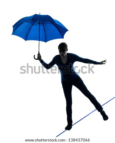 one caucasian woman holding umbrella  in silhouette studio isolated on white background