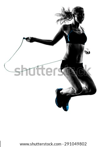 one caucasian woman Jumping Rope exercises  in studio silhouette isolated on white background - stock photo