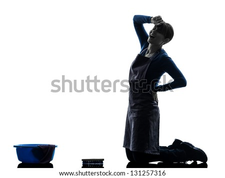 one caucasian woman maid cleaning backache washing floor   in silhouette studio isolated on white background - stock photo