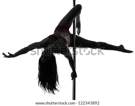 one caucasian woman pole dancer dancing in silhouette studio isolated on white background - stock photo
