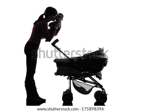 one caucasian woman prams holding baby kissing silhouette on white background - stock photo