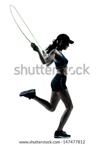 one caucasian woman runner jogger jumping rope in silhouette studio isolated on white background - stock photo