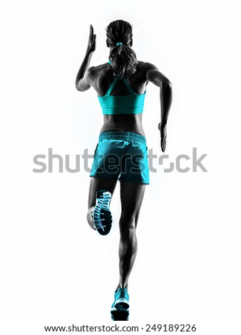 one caucasian woman runner running jogger jogging rear view in studio silhouette isolated on white background - stock photo