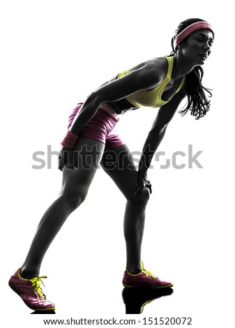 one caucasian woman runner running pain muscle cramp in silhouette on white background - stock photo