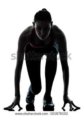 one caucasian woman sprinter on starting block in silhouette studio isolated on white background - stock photo