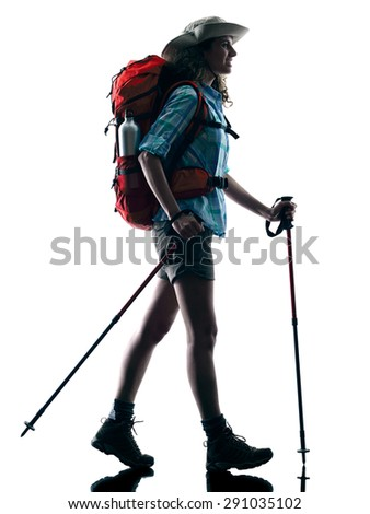 one caucasian woman trekker trekking walking nature in silhouette isolated on white background - stock photo