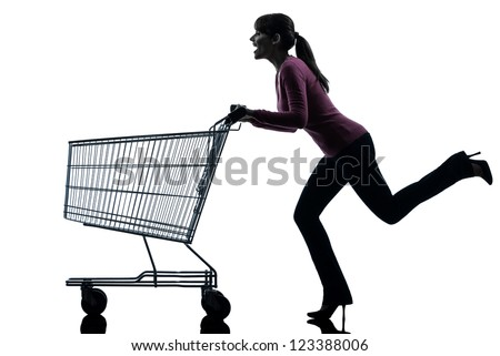 one caucasian woman with empty shopping cart in silhouette studio isolated on white background - stock photo