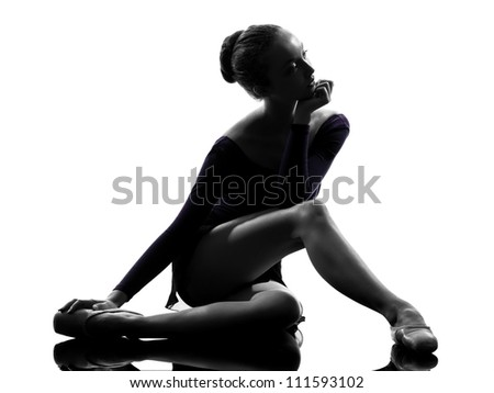one caucasian young woman ballerina ballet dancer stretching warming up in silhouette studio on white background - stock photo