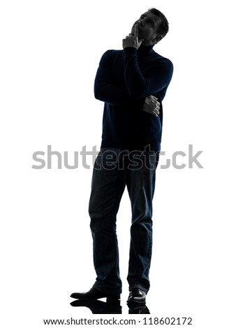 one causasian man doubtful thinking full length in silhouette studio isolated on white background