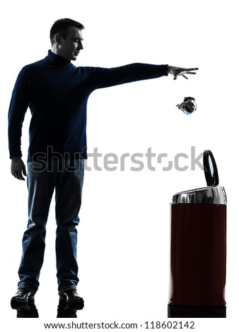 one causasian man dropping a paper in a trash bin full length in silhouette studio isolated on white background - stock photo