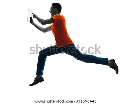 one causcasian man running Digital Tablets  in silhouette isolated on white background - stock photo