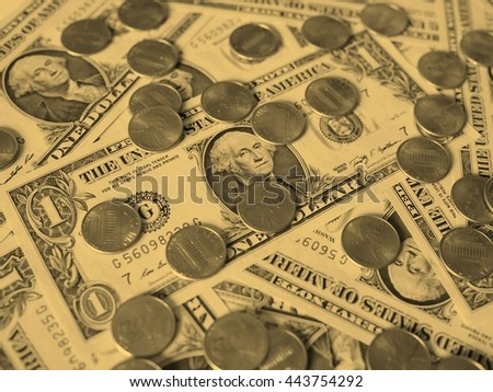 One cent coins and One Dollar banknotes  currency of the United States useful as a background - vintage sepia look - stock photo