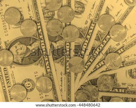 One cent coins and One Dollar banknotes  currency of the United States useful as a background in black and white - vintage sepia look - stock photo