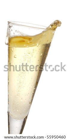 one champagne glass with champagne splashing out of it - stock photo