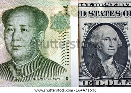 One Chinese Yuan bill (Mao Zedong) on one American Dollar money (George Washington.Concept photo of money economy currency strategy growth corporate assets,national debt debtor world power leaders.