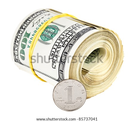 One chinese yuan coin versus bundle of rolled up US dollars, currency concept photo - stock photo