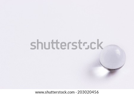 One clear glass marble - Lower right  - stock photo